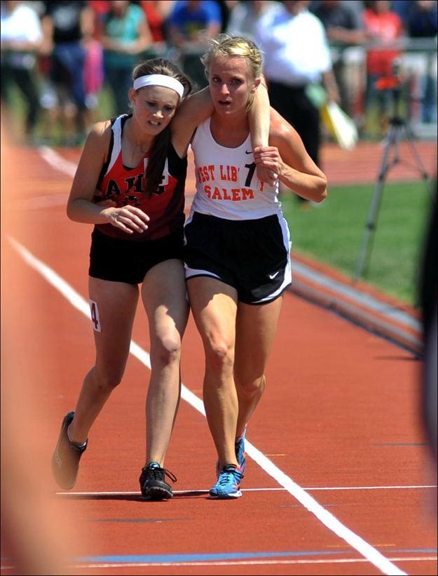 Athlete helps injured competitor