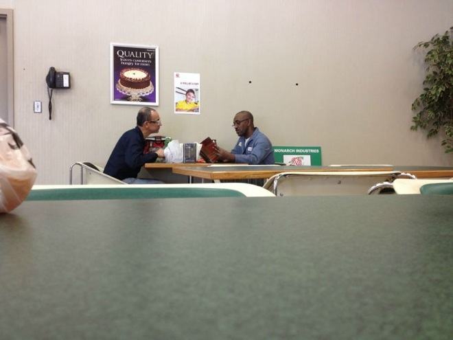 man reading to man who cant