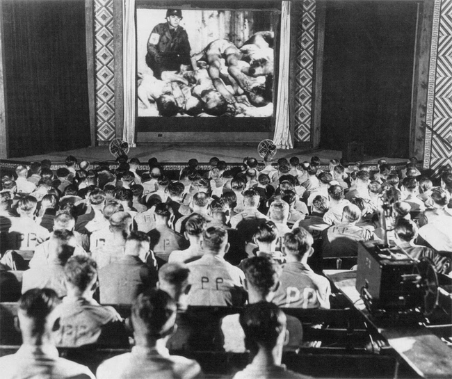 Nazi soldiers watch concentration camp footage