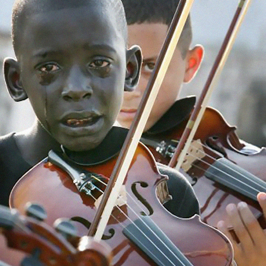boy plays violin at teacher's funeral